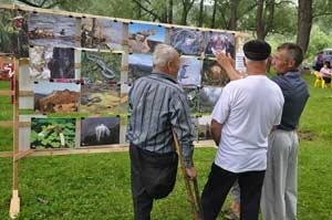 Госинспектор Олег Романов рассказывает о выставке фото Нехорошевой Людмилы